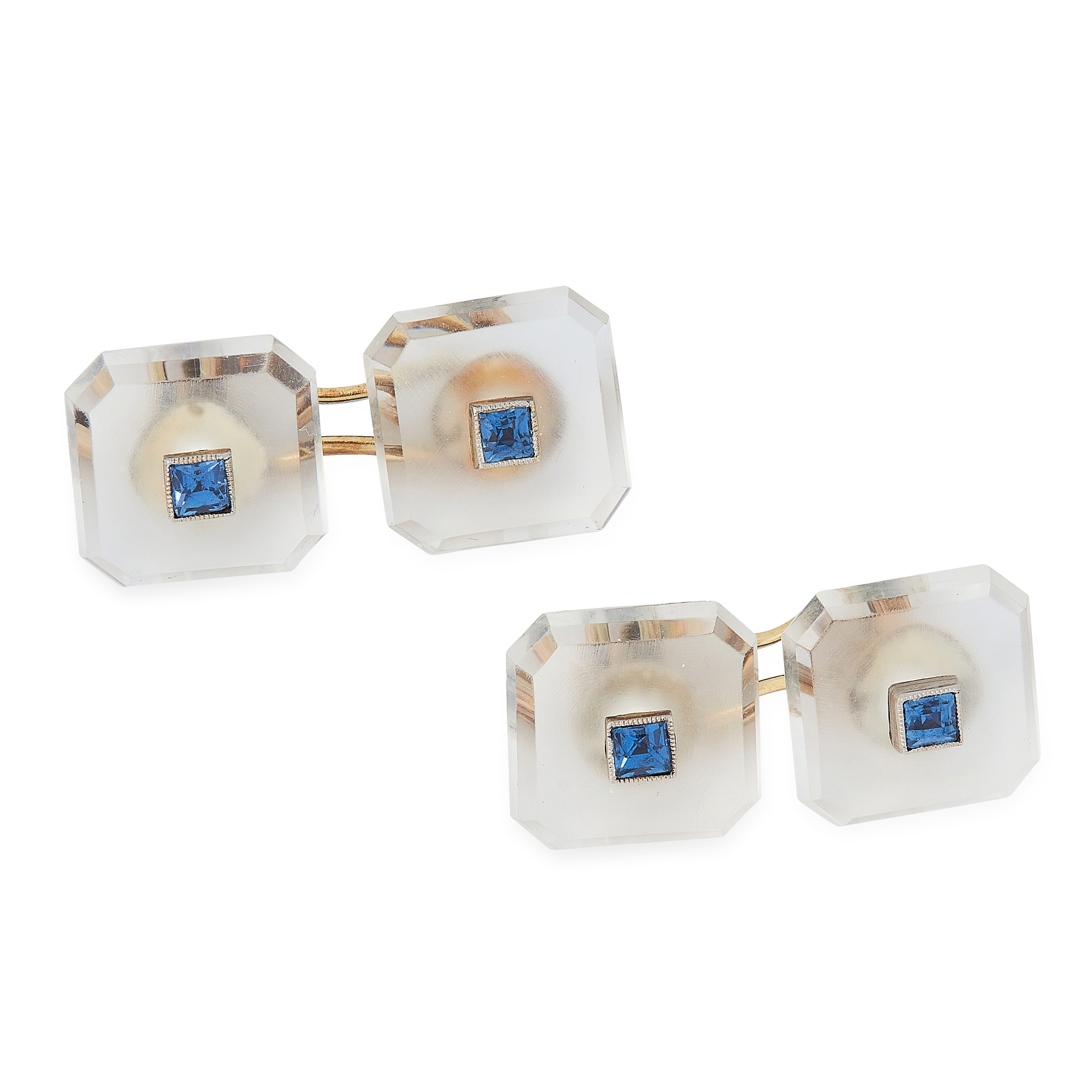 A PAIR OF SAPPHIRE AND ROCK CRYSTAL CUFFLINKS, CIRCA 1930 in yellow gold, each formed of two