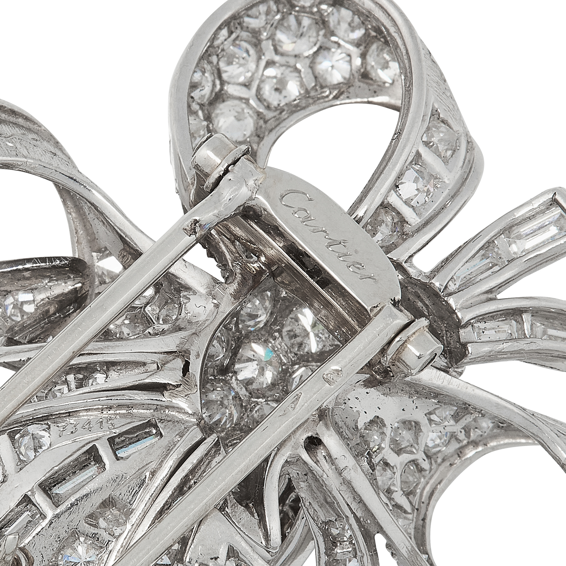 A DIAMOND BROOCH, CARTIER CIRCA 1950 in platinum, designed as an array of ribbon motifs, jewelled - Image 2 of 2