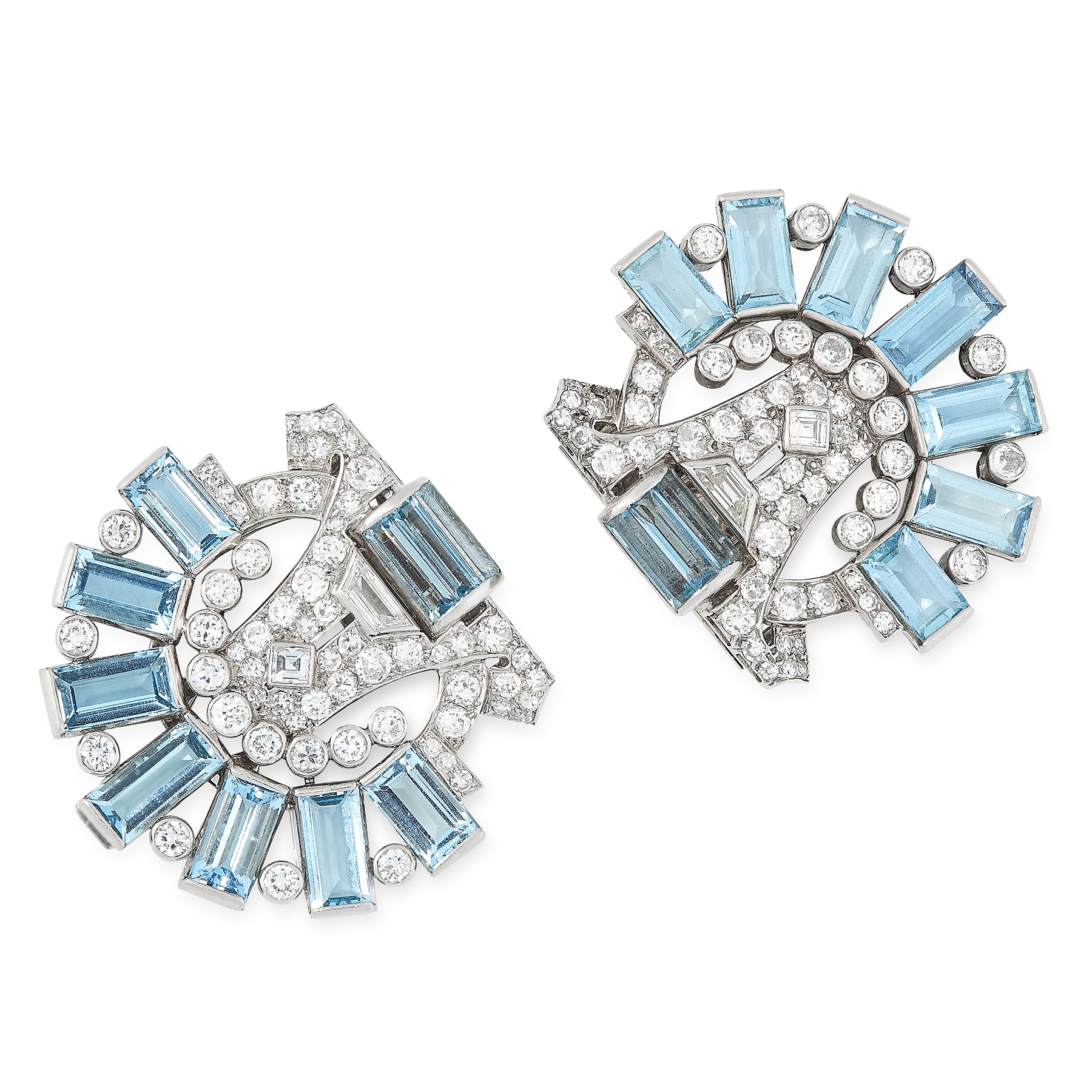A PAIR OF AQUAMARINE AND DIAMOND CLIP BROOCHES, CARTIER CIRCA 1940 in 18ct white gold, each set with