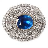 AN ANTIQUE SAPPHIRE AND DIAMOND BROOCH in yellow gold and silver, close set with a central cushion