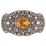 AN ANTIQUE CITRINE AND DIAMOND BROOCH in yellow gold and silver, set with a fancy cut citrine within