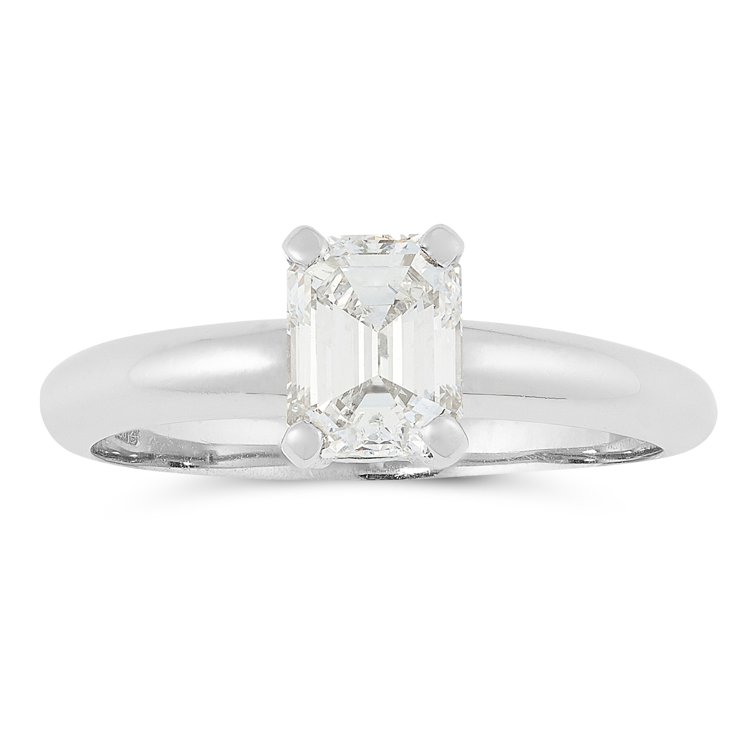 A DIAMOND SOLITAIRE RING in platinum, set with an emerald cut diamond of 1.01 carats, British
