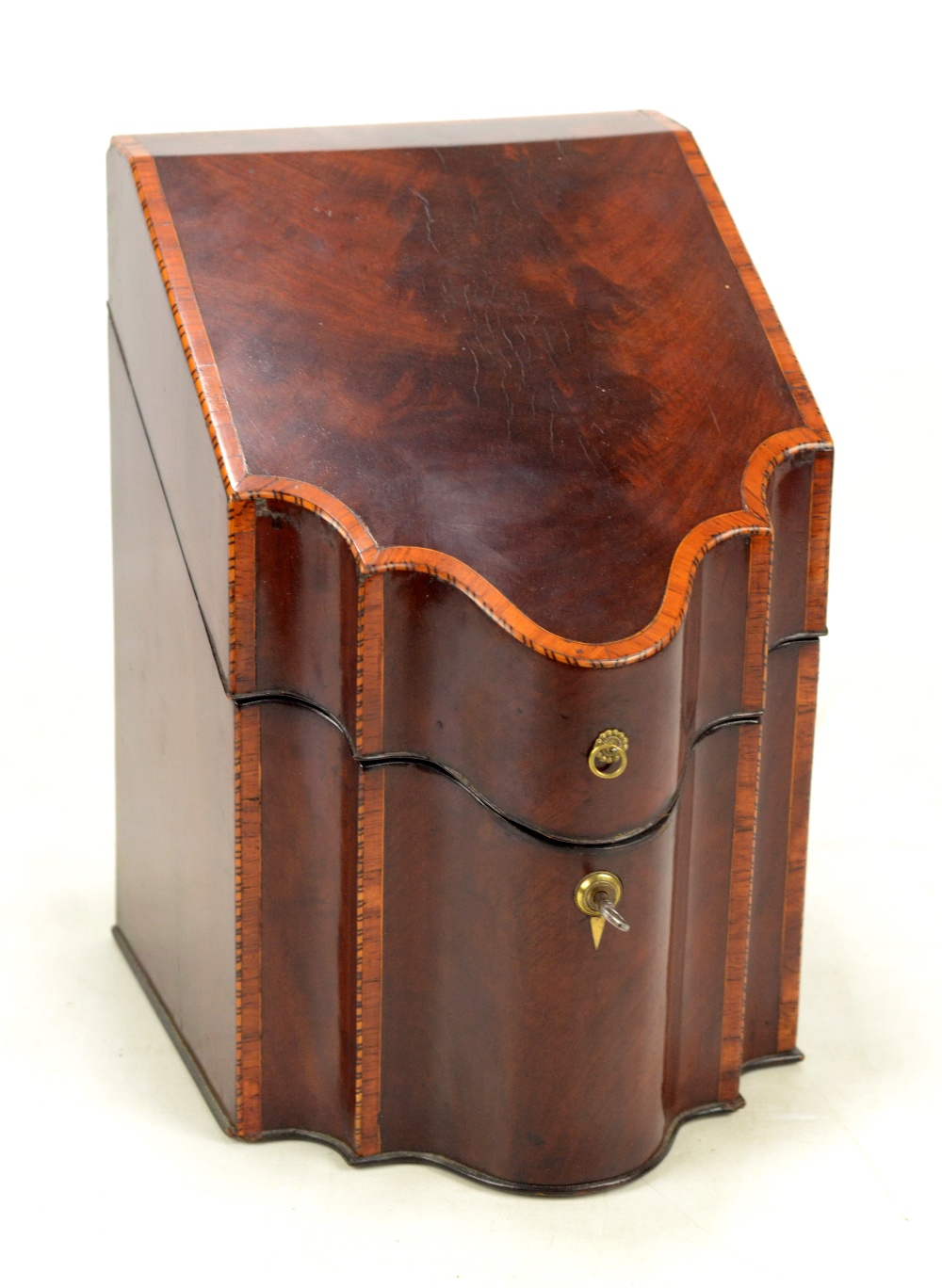 Lot 16 - A George III mahogany and satinwood crossbanded knife box of serpentine outline, height 34cm,
