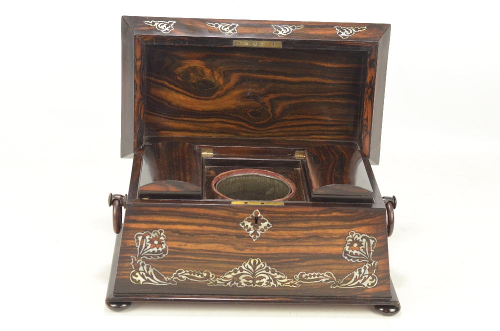 Lot 21 - An early Victorian coromandel and mother of pearl inlaid tea caddy of sarcophagus form,