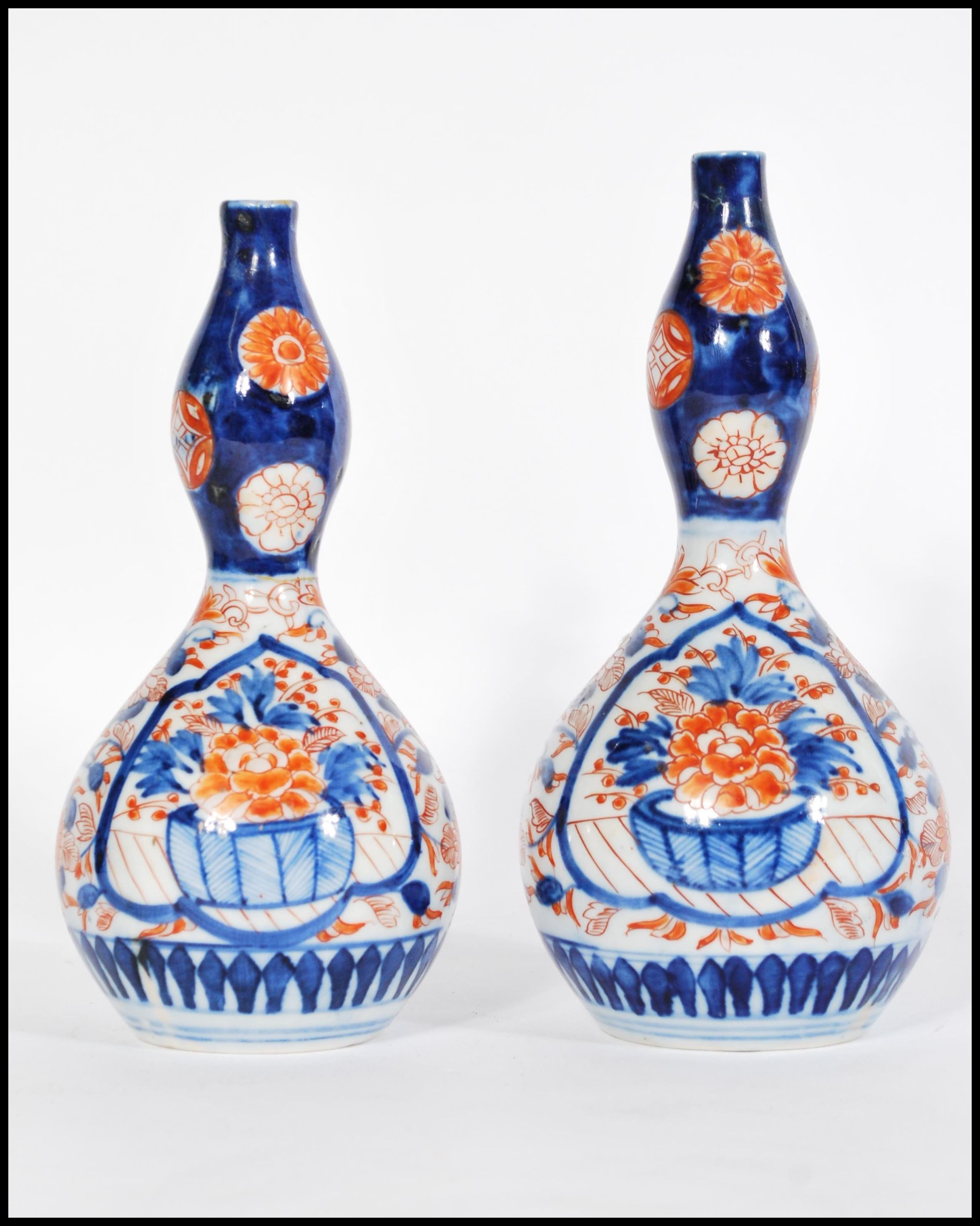 Lot 33 - A pair of 19th century Japanese Imari gourd vases having hand painted decoration.Measures 20cm-high