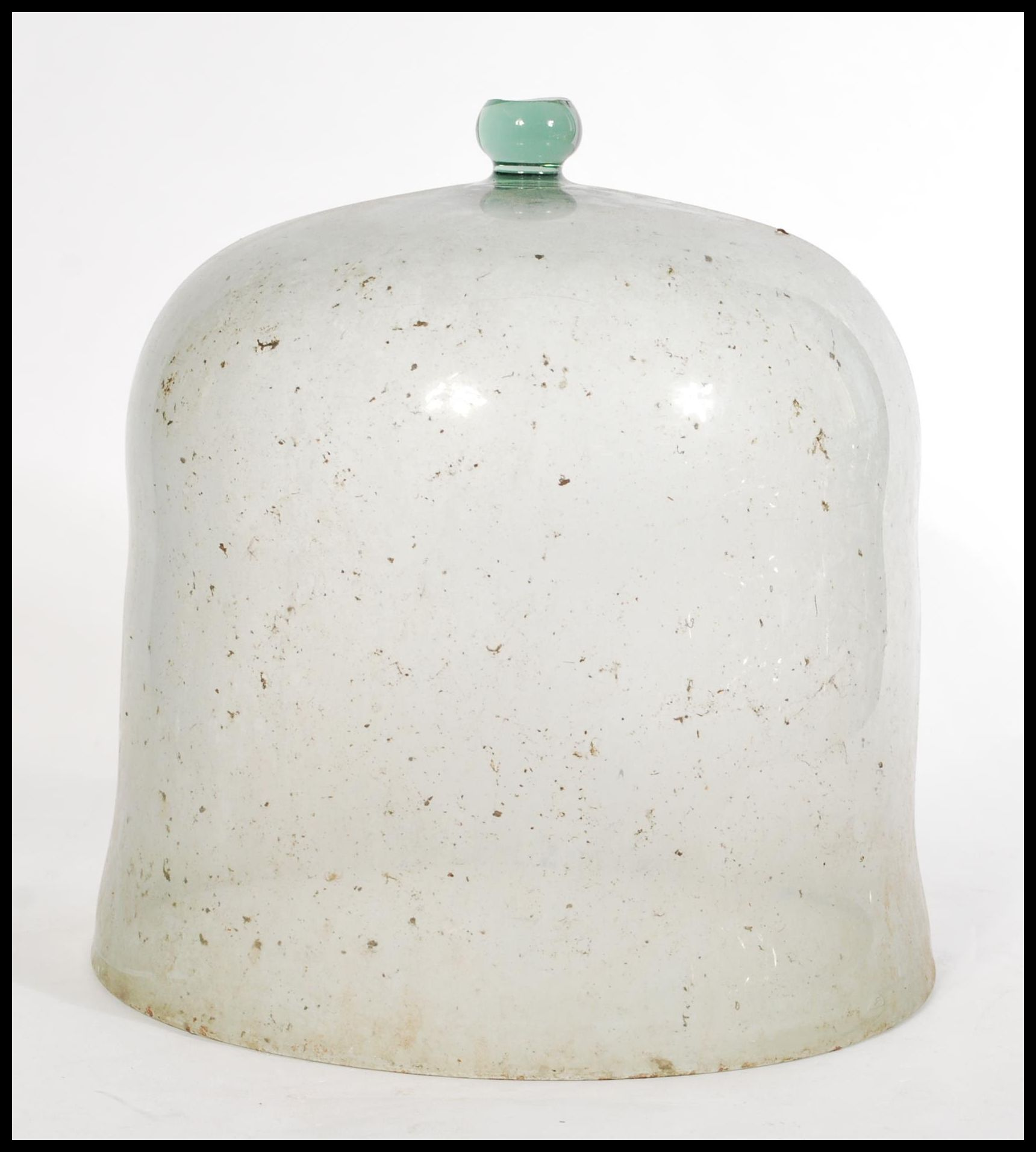 Lot 16 - A late 19th Century Victorian glass bell cloche / glass dome with a ballfinial handle to the top.
