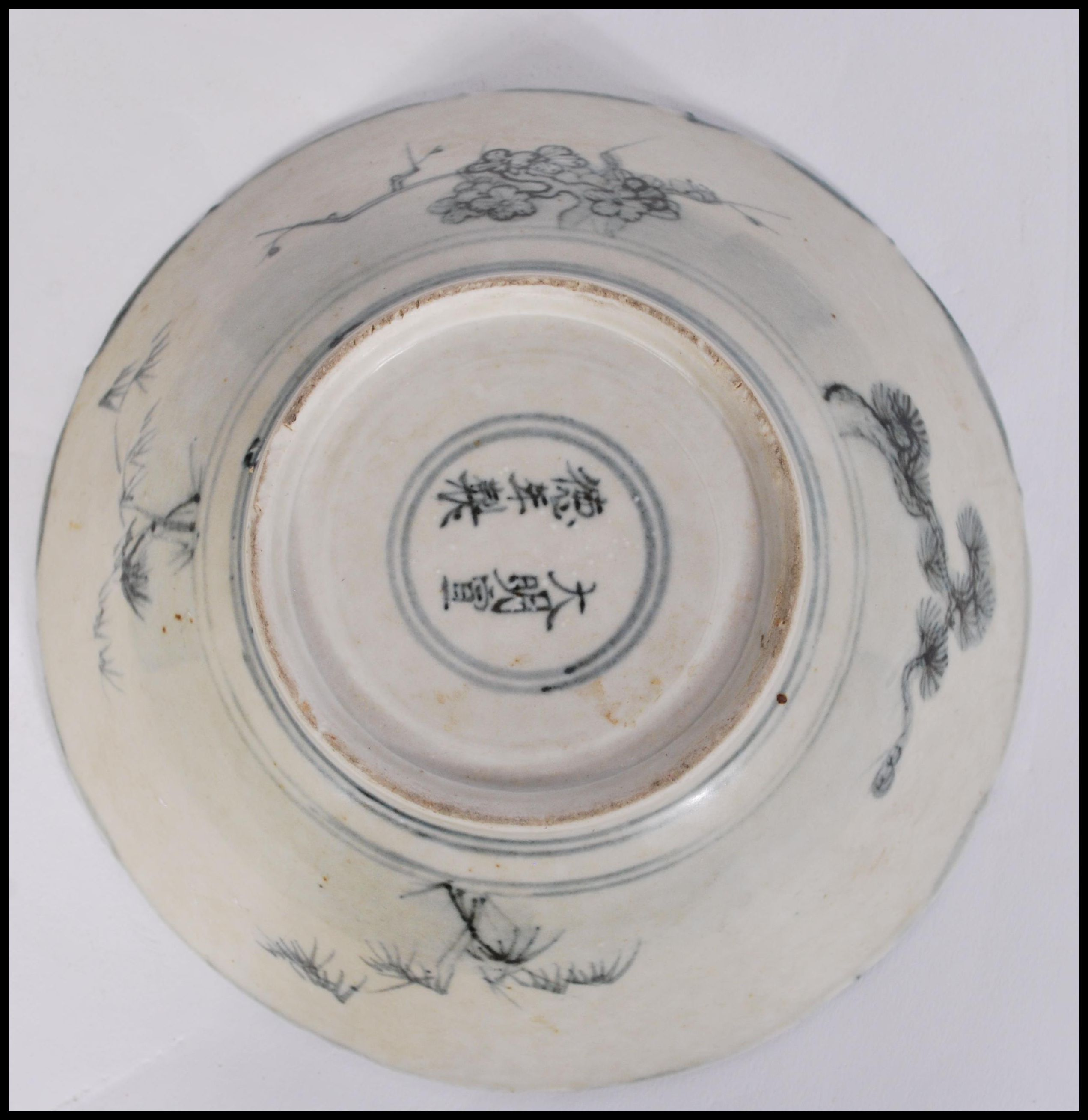 Lot 37 - A 19th century Chinese bowl having decoration of maiden with plants and geometric borders. Six