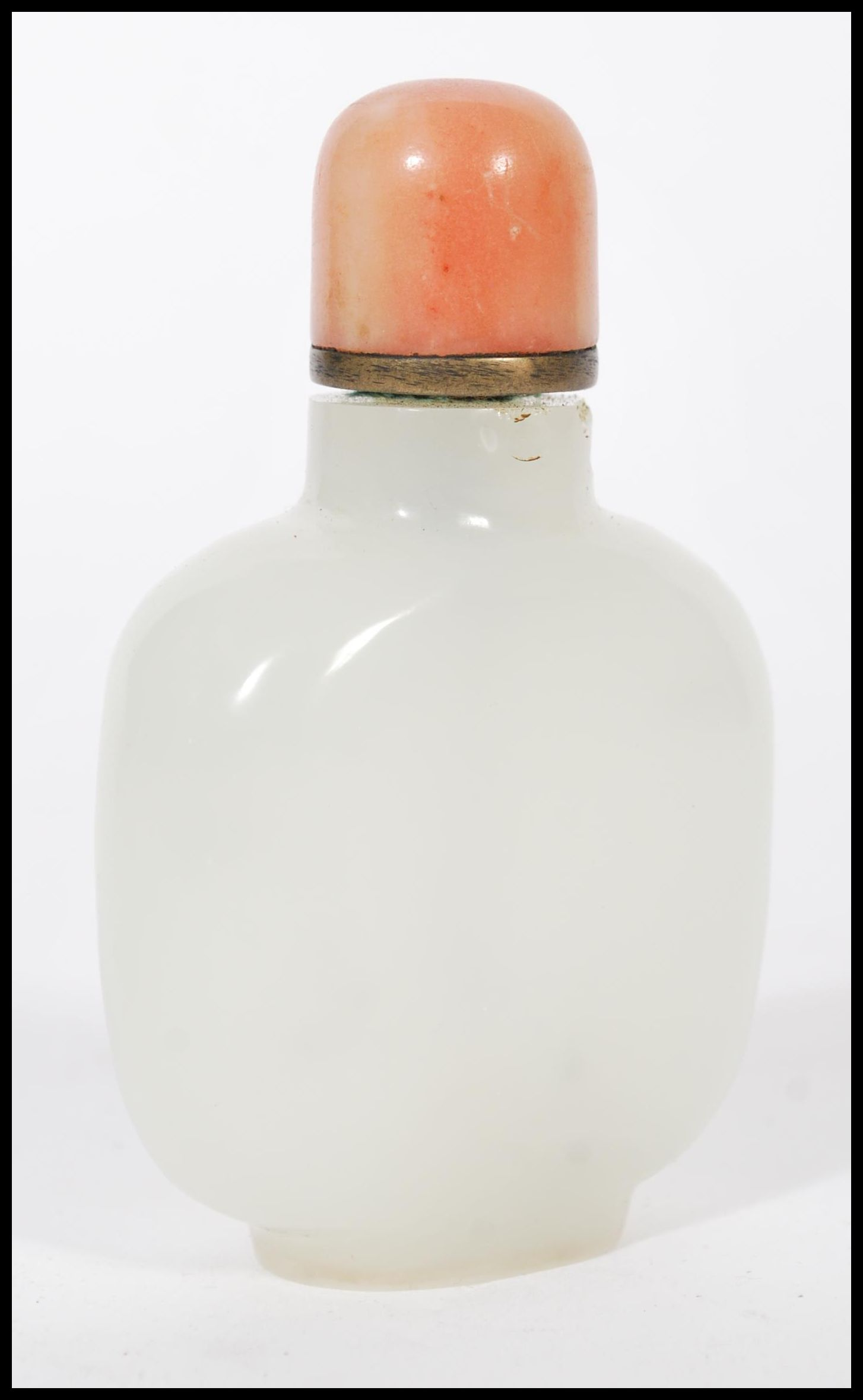 Lot 5 - A 19th century Chinese white / light green jade snuff bottle with red coral top complete with