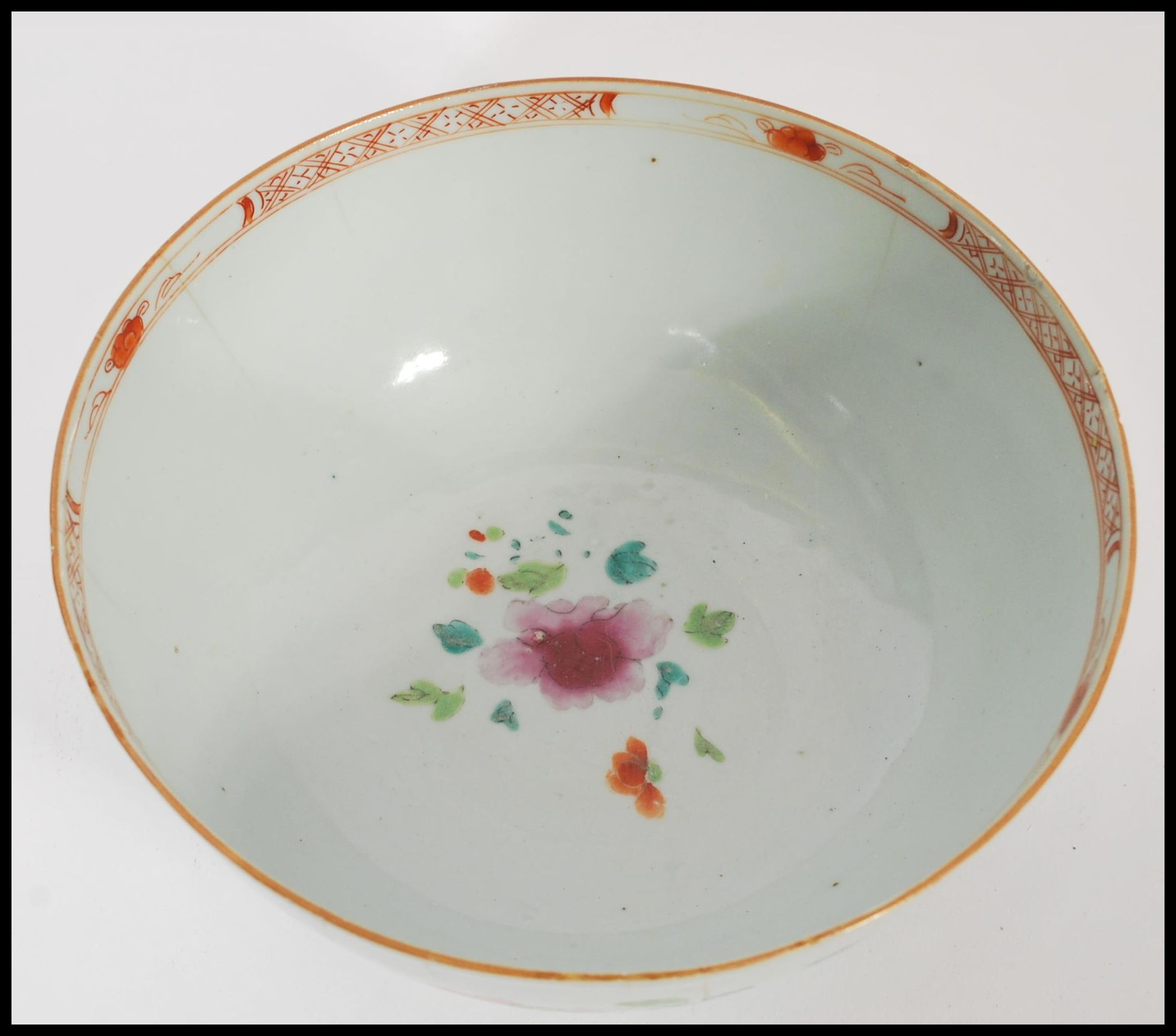 Lot 14 - An 18th century small Cantonese Chinese ceramic bowl having hand painted floral spray with trees