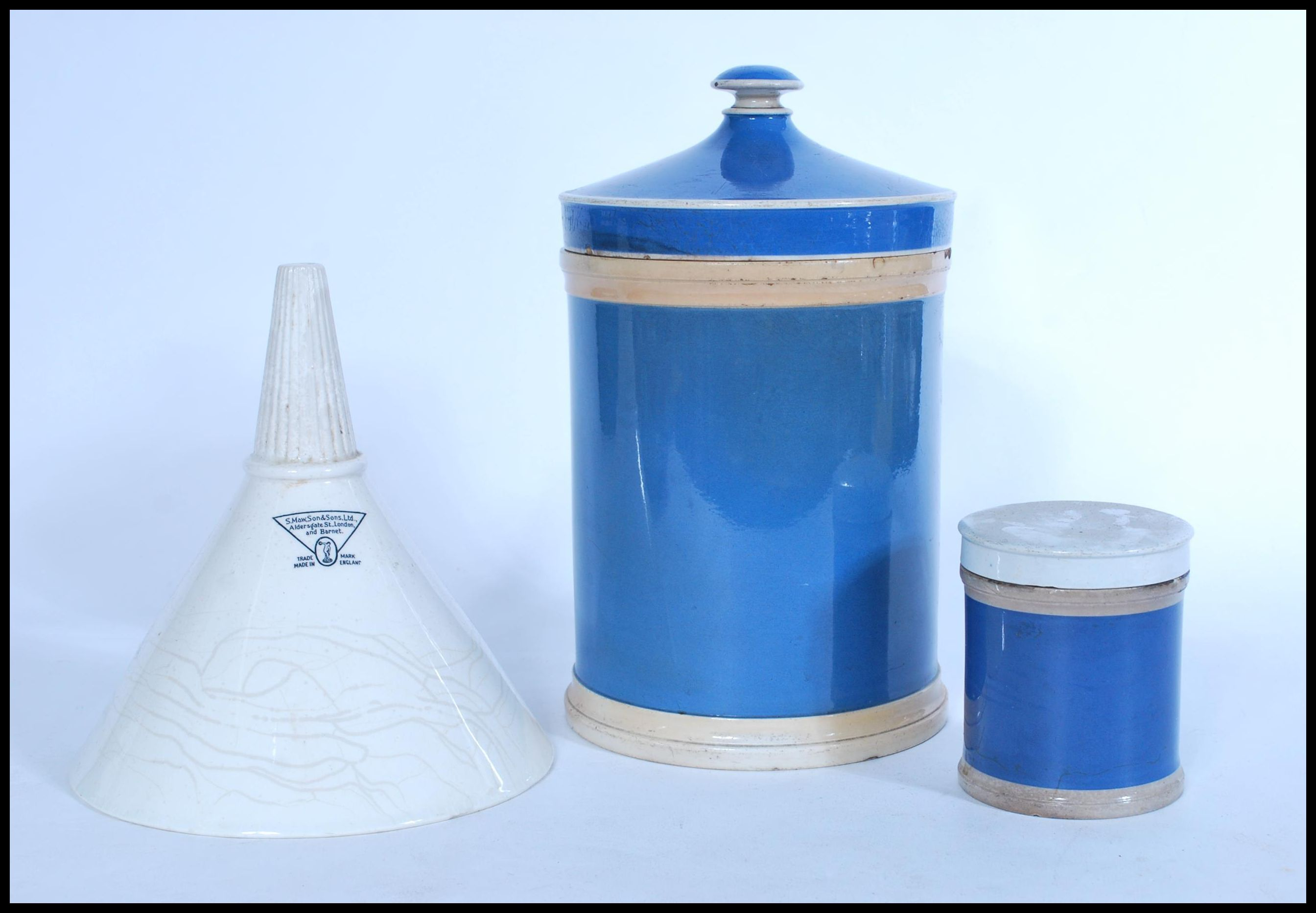 Lot 19 - A selection of late 19th Victorian apothecary wares to include an S. Maw, Son & Sons, Ltd. white