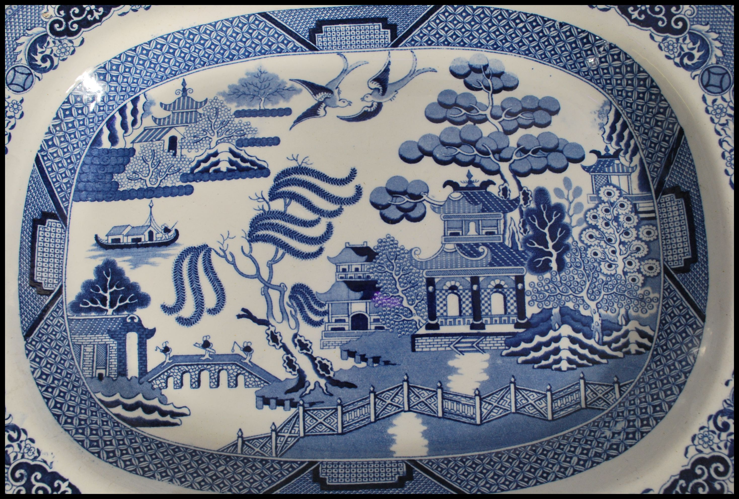 Lot 20 - A selection of 19th century Victorian blue and white meat platters transfer printed in willow