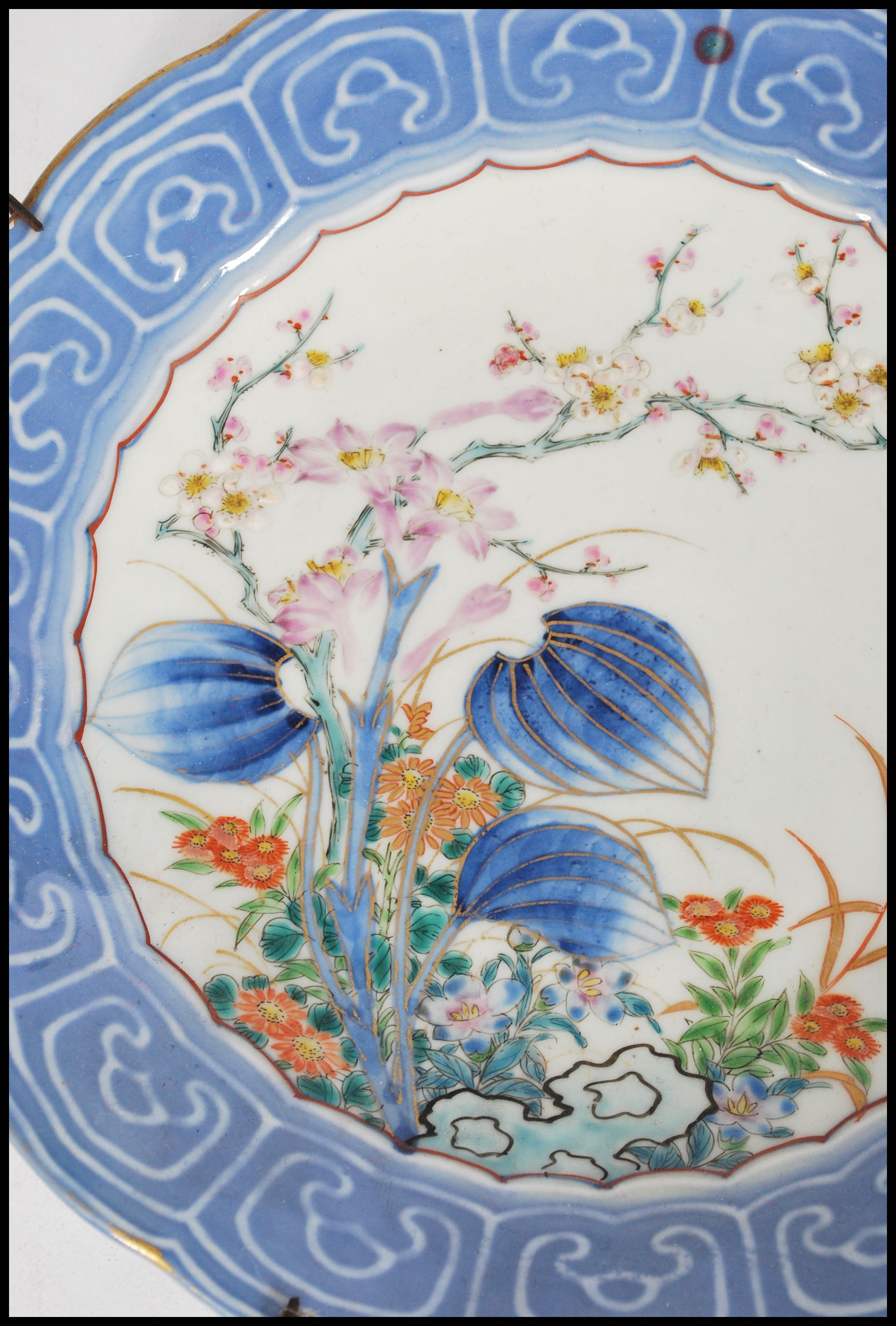 Lot 12 - A late 19th century Chinese blue and white porcelain plate having a large blue and white helmet