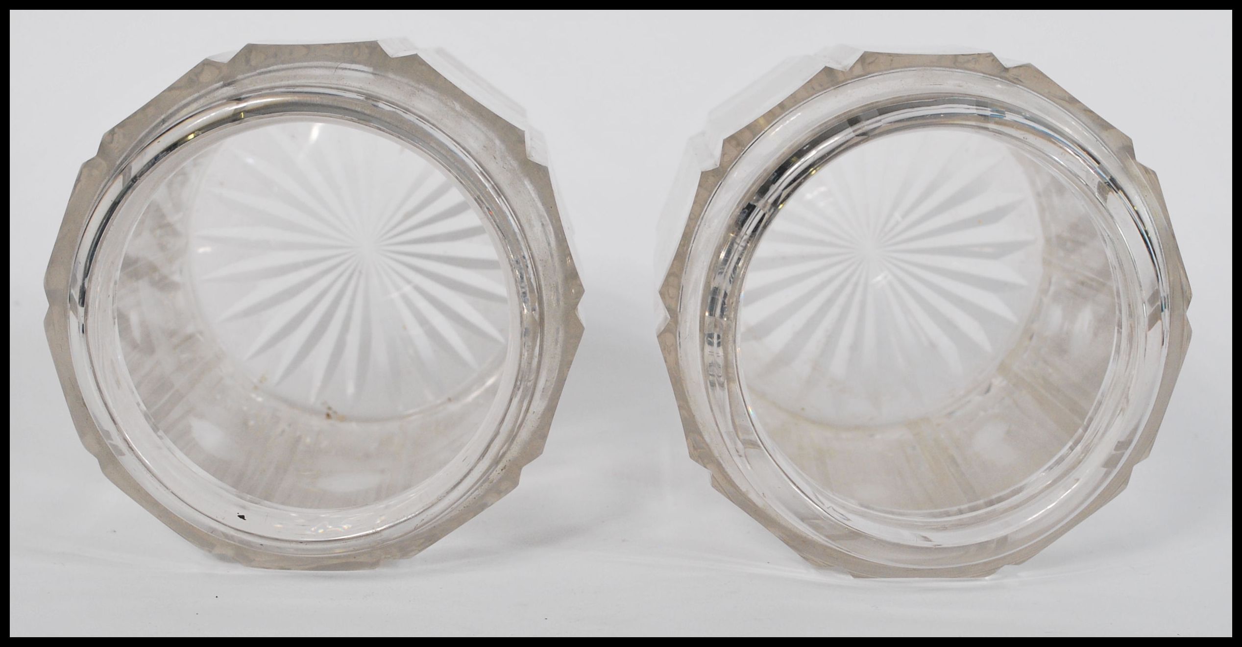Lot 57 - A pair of 19th century facet cut glass jars of cylindrical form having shaped necks believed to be