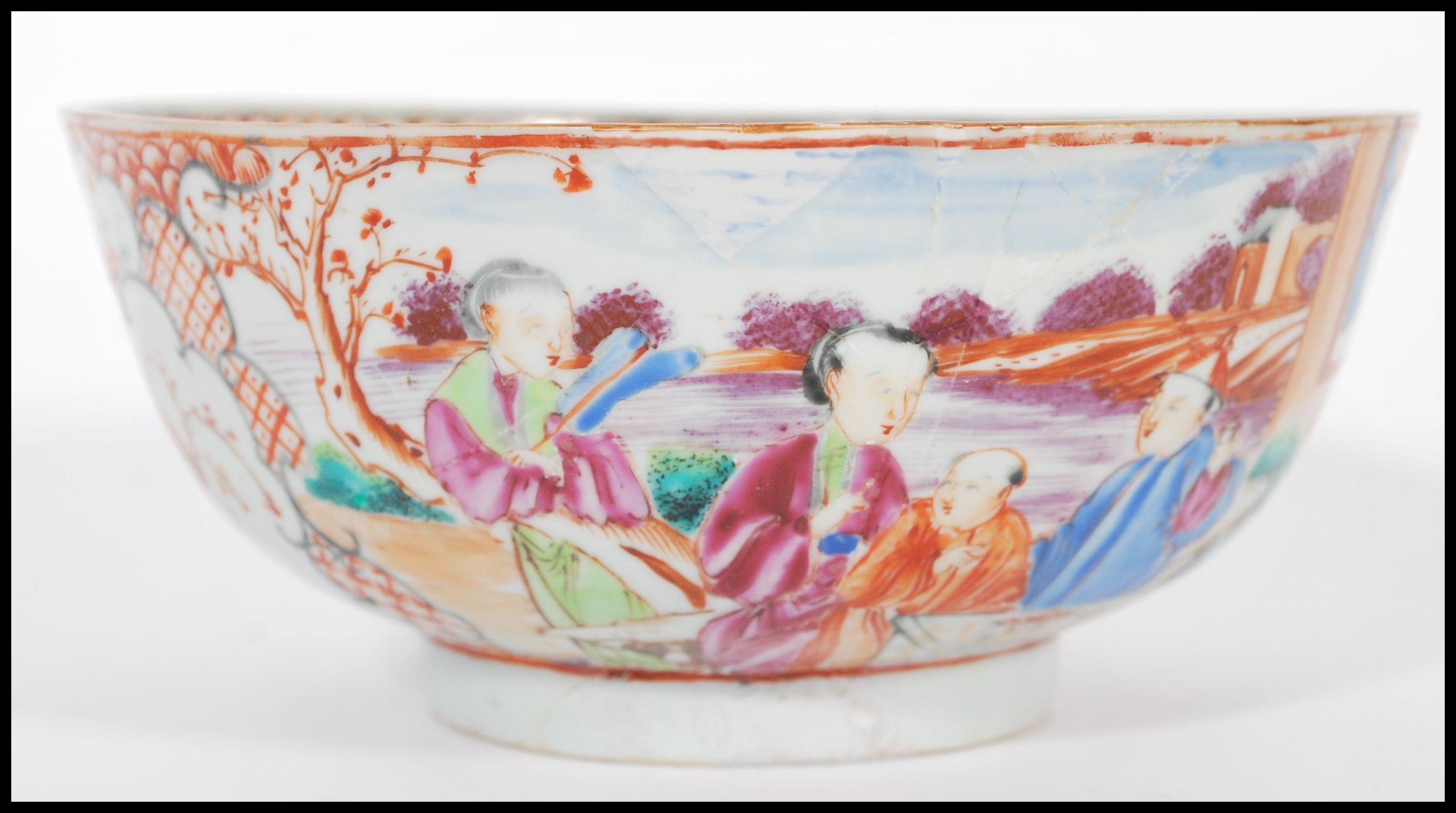 Lot 6 - An 18th Chinese ceramic bowl having hand painting white cartouche panels depicting birds and trees