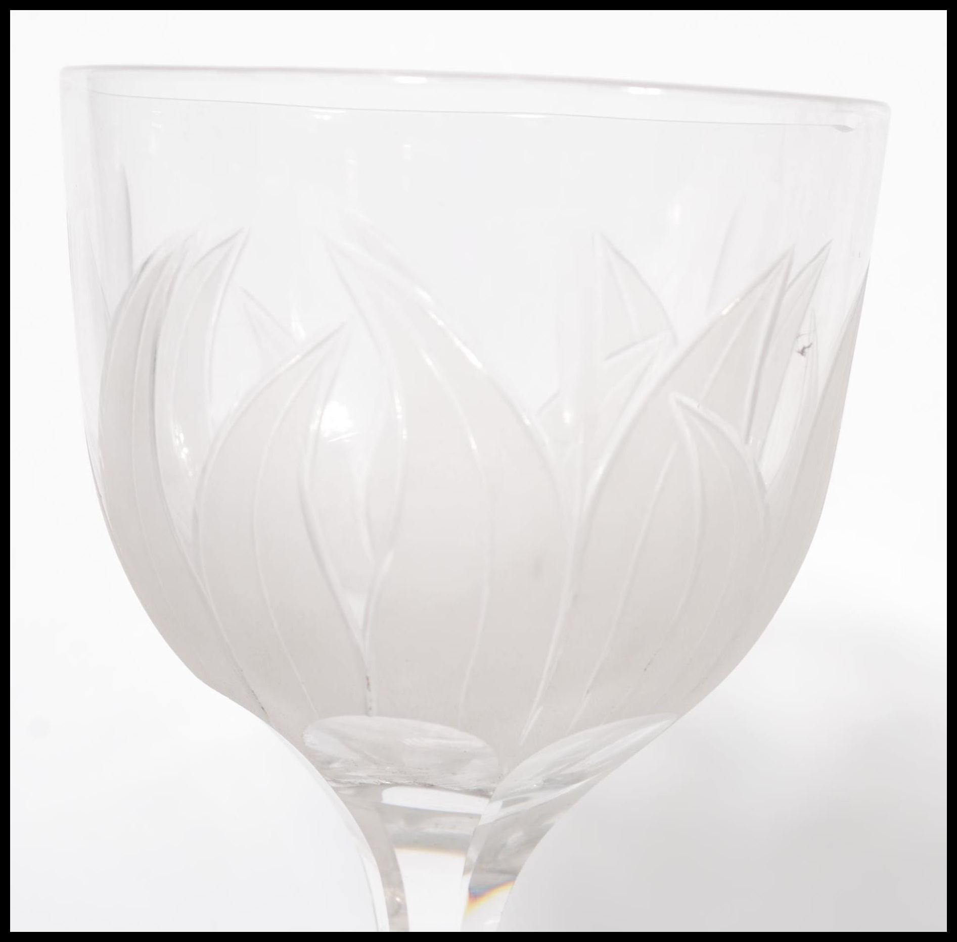 Lot 59 - A set of 6 French 20th century cut - acid etched wine glasses. Each bowl with decorated