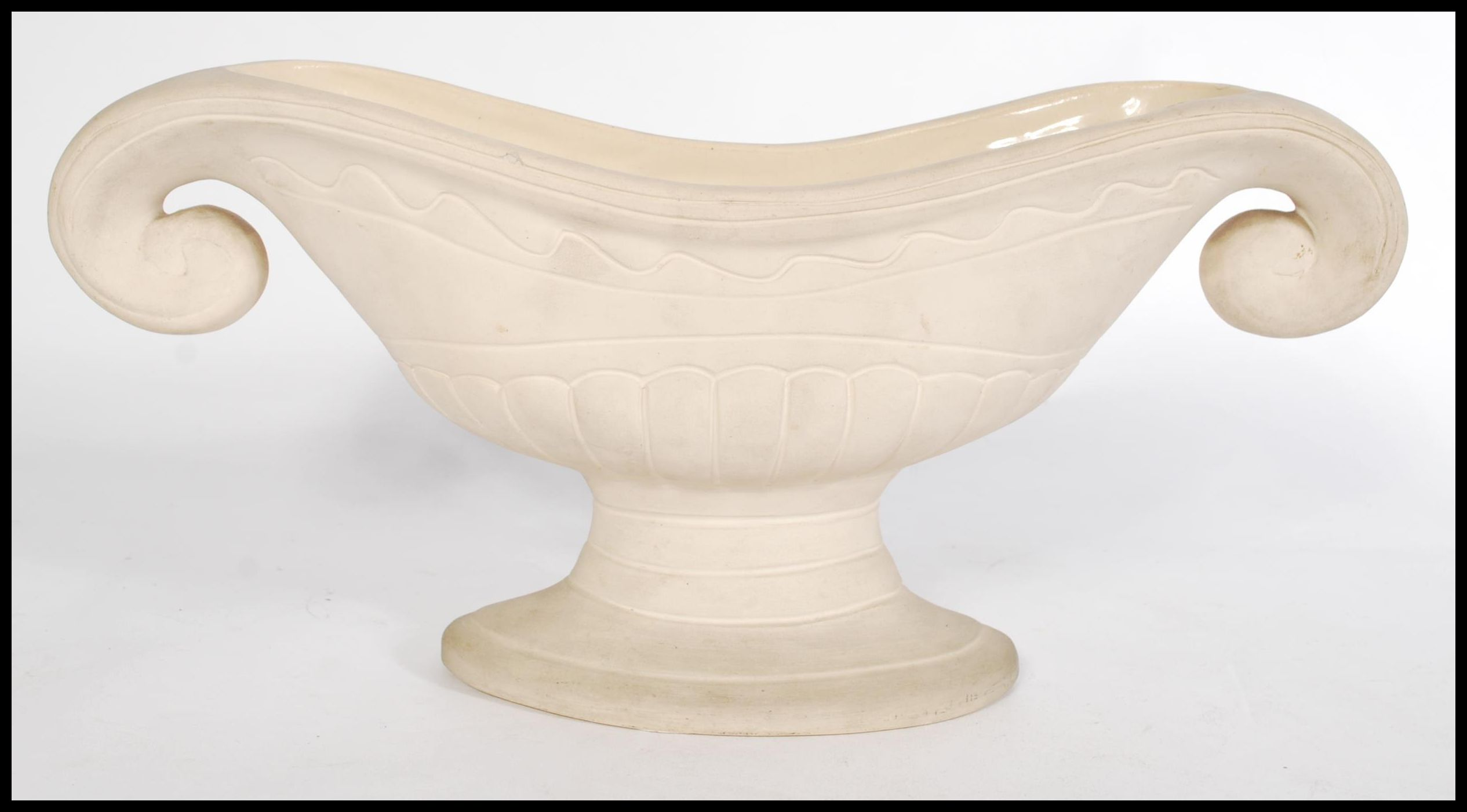 Lot 23 - A vintage 20th century cream glazed pottery plant vase, by florist and designer Constance Spry for