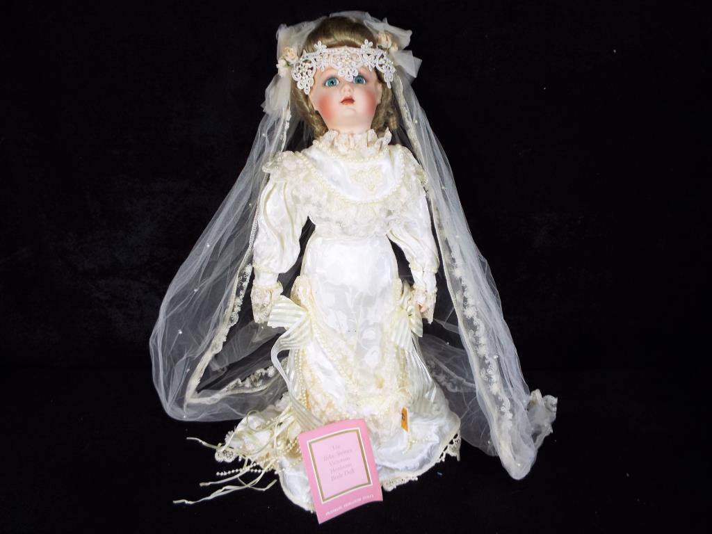 Lot 62 - Franklin Doll - a Victorian style Heirloom Bride doll by Franklin, fully dressed with stand,