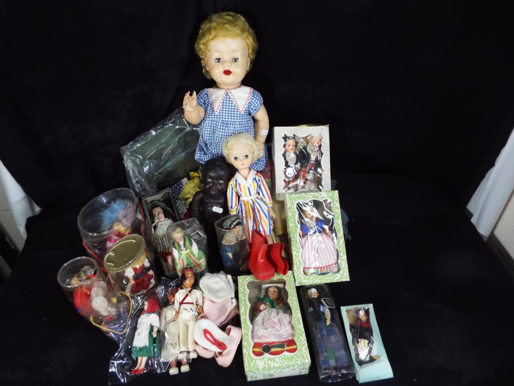 A collection of three mid-century dolls to include a black Marie-Mia doll approximately 5 cm (h),