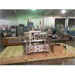 Quadrel wrap around labeler, model Versaline, single head with Open Date coder, timing feed screw,