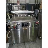 Kalish inline bottle cleaner, model B-CL, cleans by dry air blast and vacuum assist, set up for 4