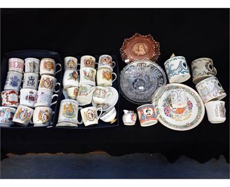 A COLLECTION OF ROYAL COMMEMORATIVE MUGS to include Wedgwood, a pressed glass Victorian dish and similar commemorative wares