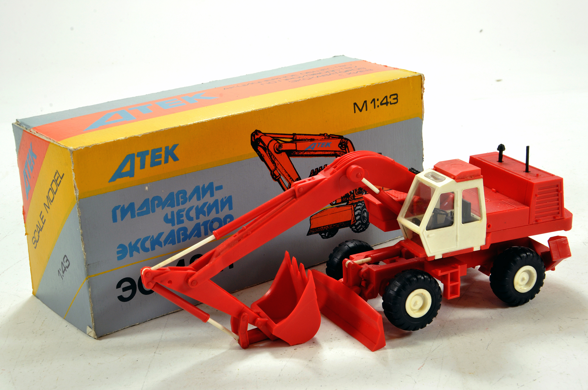 Lot 674 - Scarce ATEK (Russia) 1/43 plastic made Wheeled Excavator in livery of O&K. E to NM in Box.