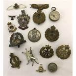 A collection of Military badges and cap badges.