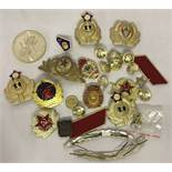 A bag of Cold War style metal Soviet badges and insignia.