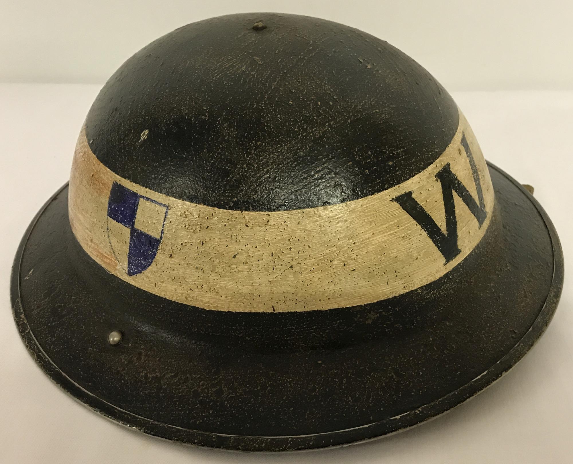 A British MK II Civil Defence/Home Front steel helmet c1939.