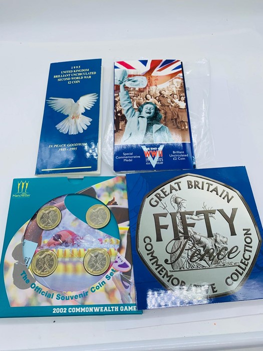 Lot 27 - Four Collector Coin packs: End of WWII 1945-2005 commemorative £2 coin,1995 Peace and Goodwill £2