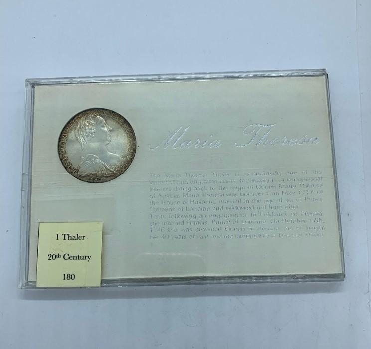 Lot 41 - A presentation case 1 Maria Theresa 1 Thaler silver bullion coin.
