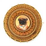 AN ANTIQUE REVERSE INTAGLIO HAIRWORK MOURNING BROOCH in high carat yellow gold, set with a central