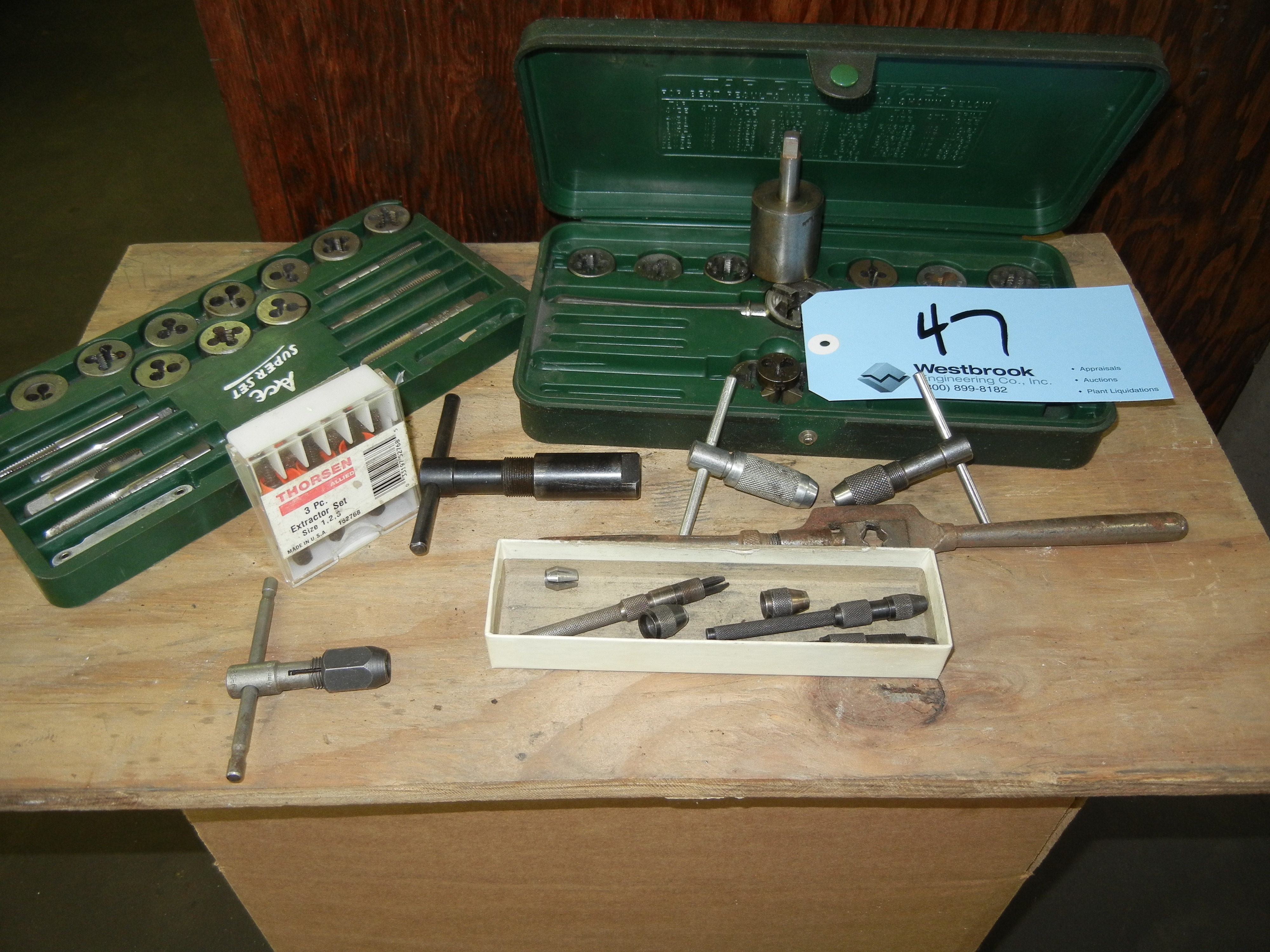 Tap and die set on table