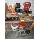 Hand tools, car accessories on top and below table, tool box, circular saw