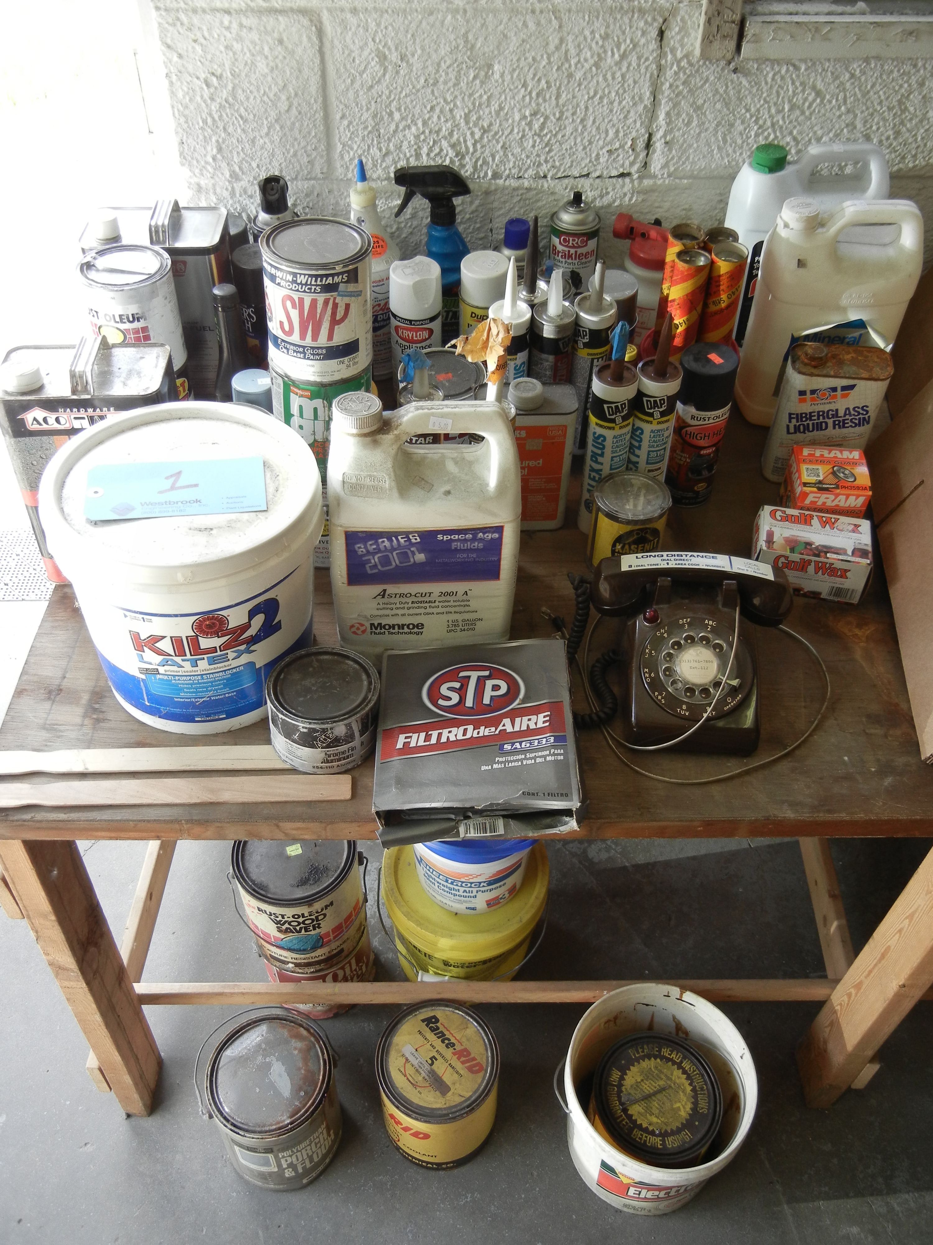 Household of maintenance items on top of table and below table