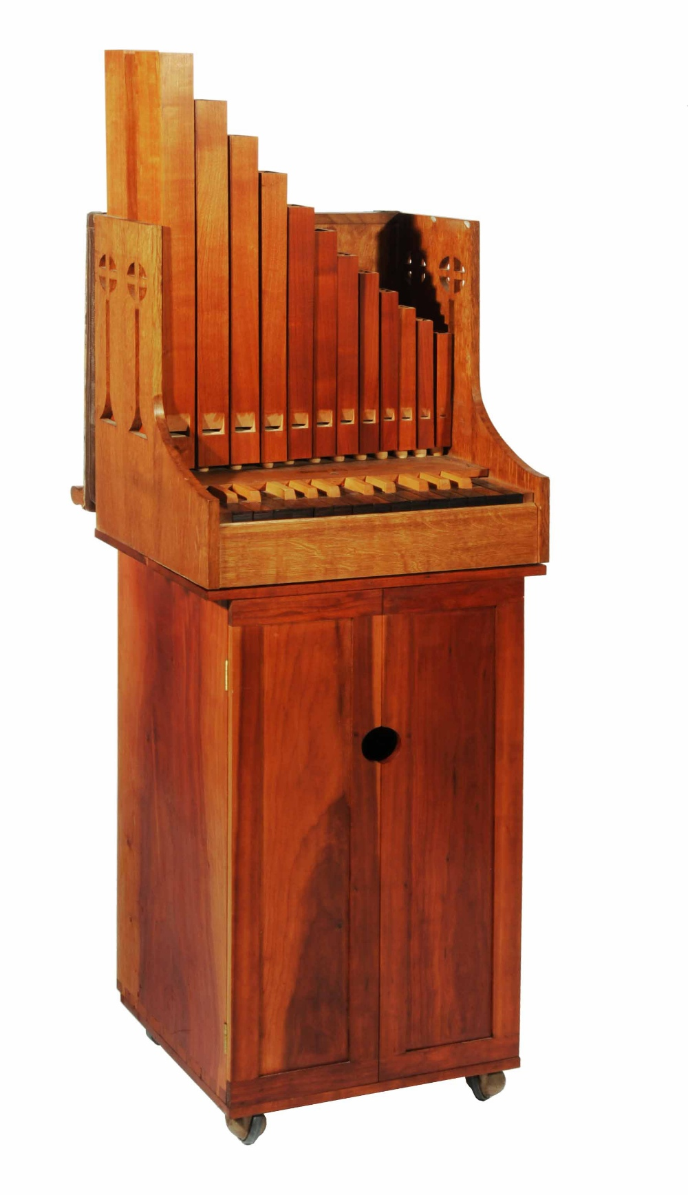 A PORTATIVE ORGAN AND STAND made by Donald Gill, the organ of traditional form with twenty five