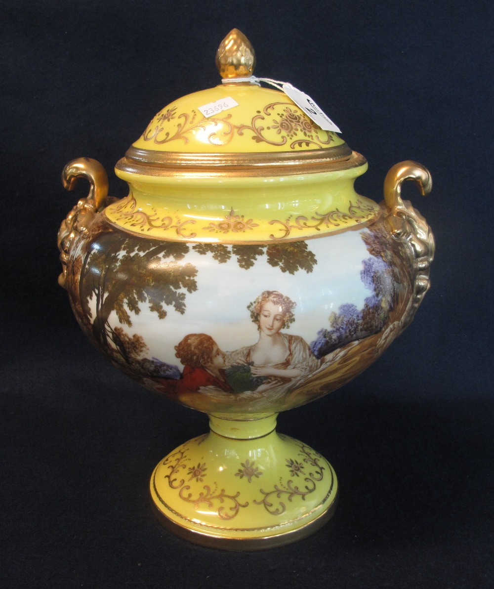 Lot 2 - Continental porcelain two handled jar of baluster form with classical figurines and moulded foliate
