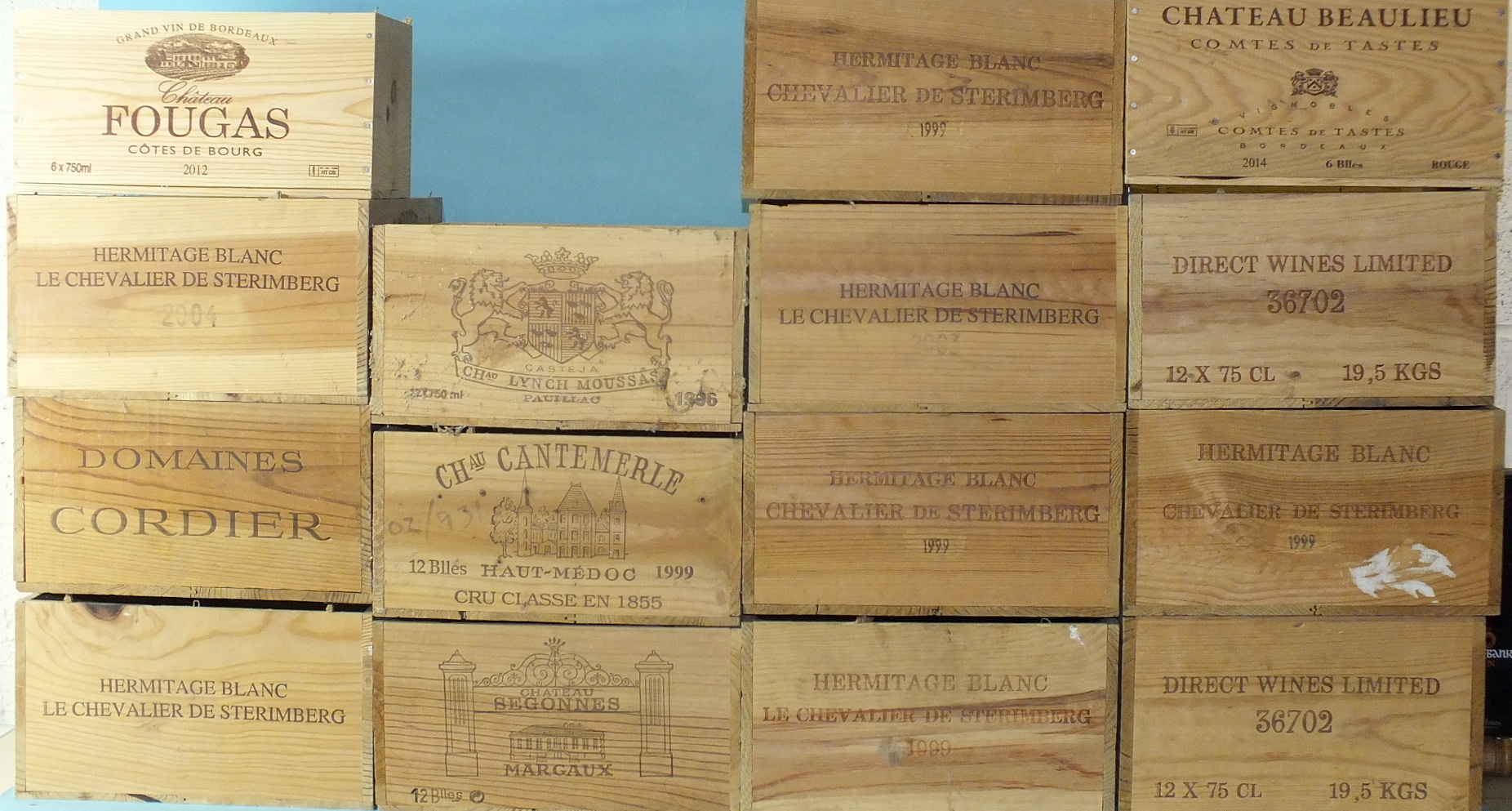 Lot 55 - A collection of fifteen wooden wine boxes, stencilled with the names of chateaux.
