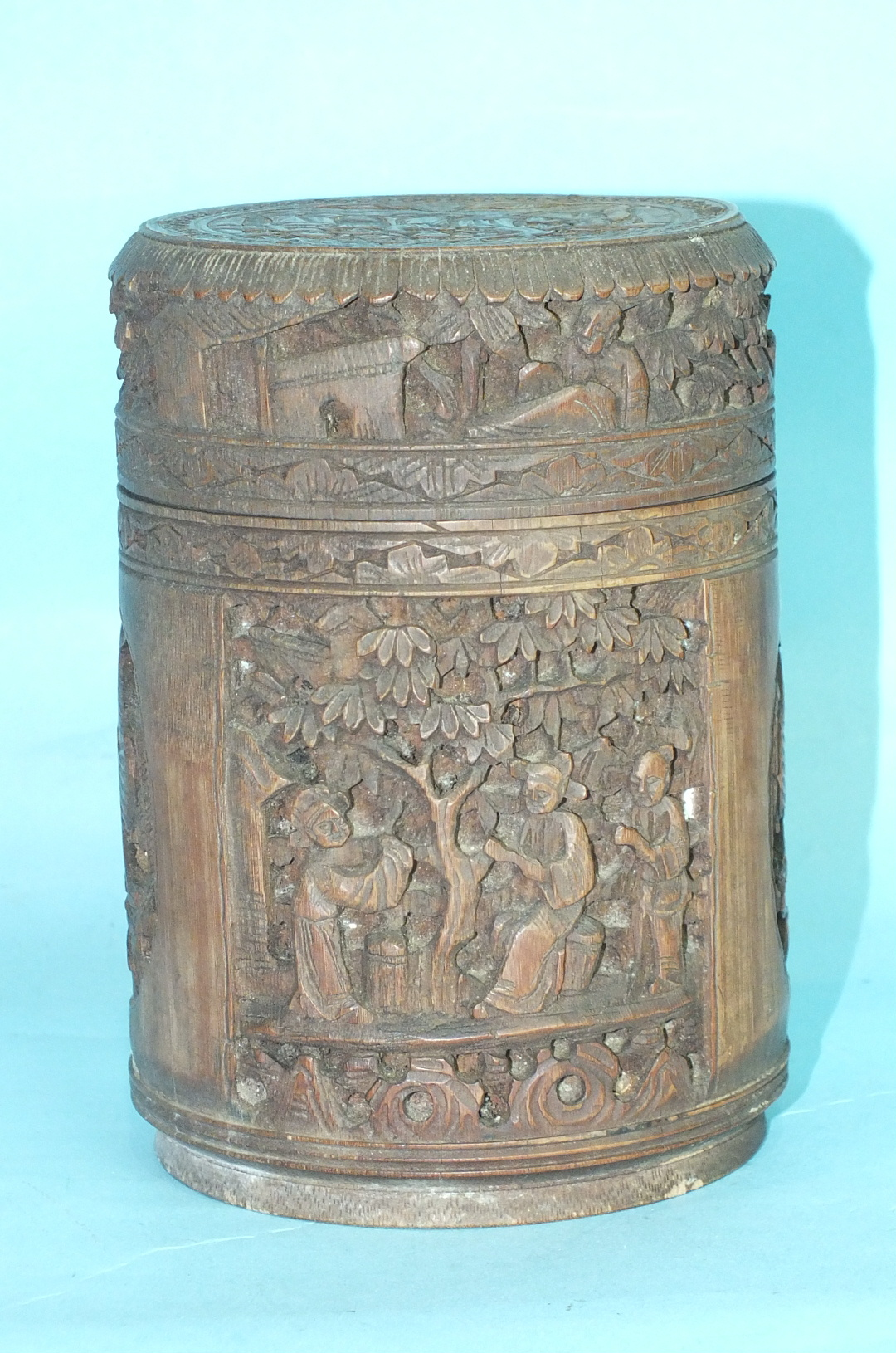 Lot 253 - A late-19th century carved bamboo pot and cover carved with panels of figures and exotic birds,