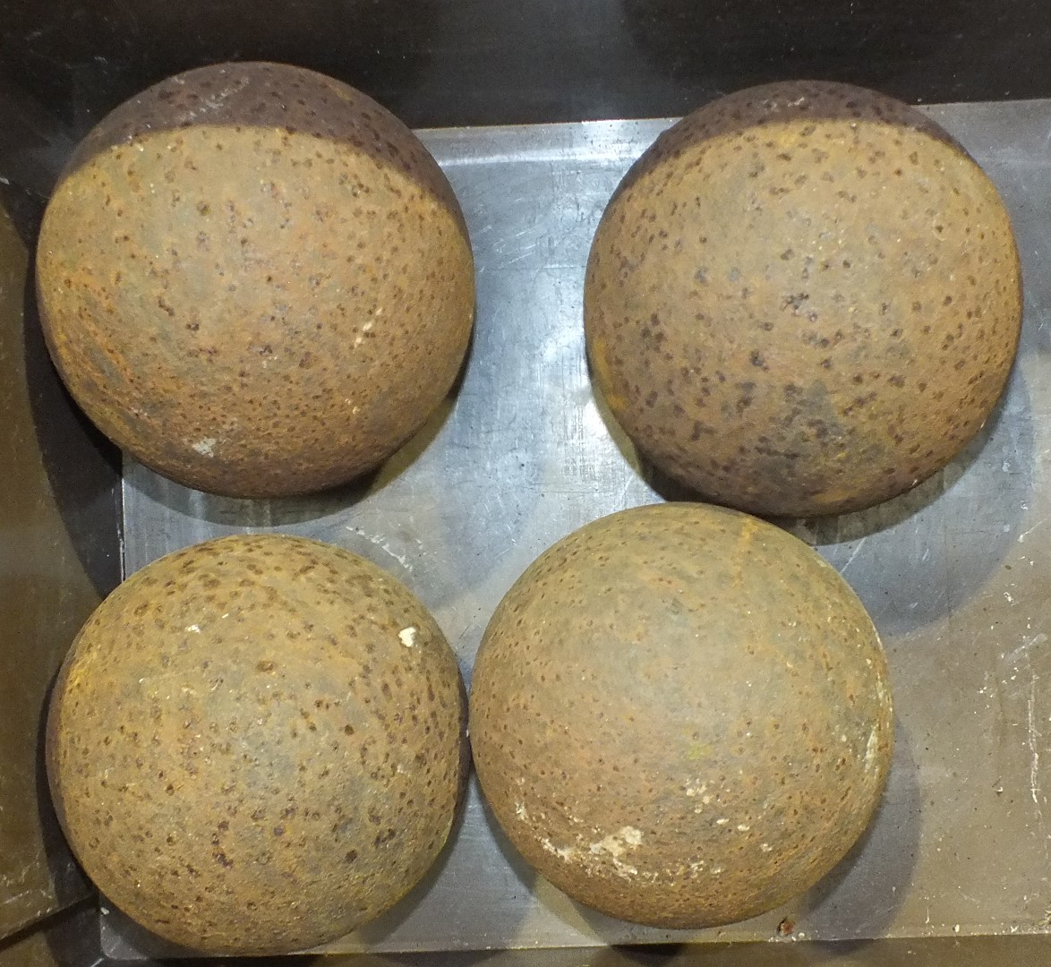 Lot 137 - Four iron cannon balls, 14cm diameter, (4).