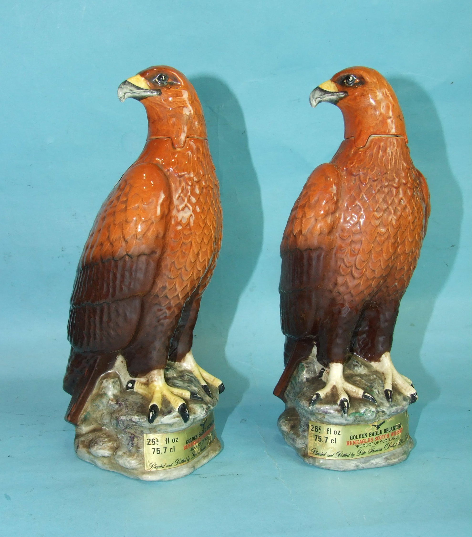 Lot 52 - Two Beswick Beneagles Scotch Whisky decanters in the form of Golden Eagles, 70%, 26? fl. oz,