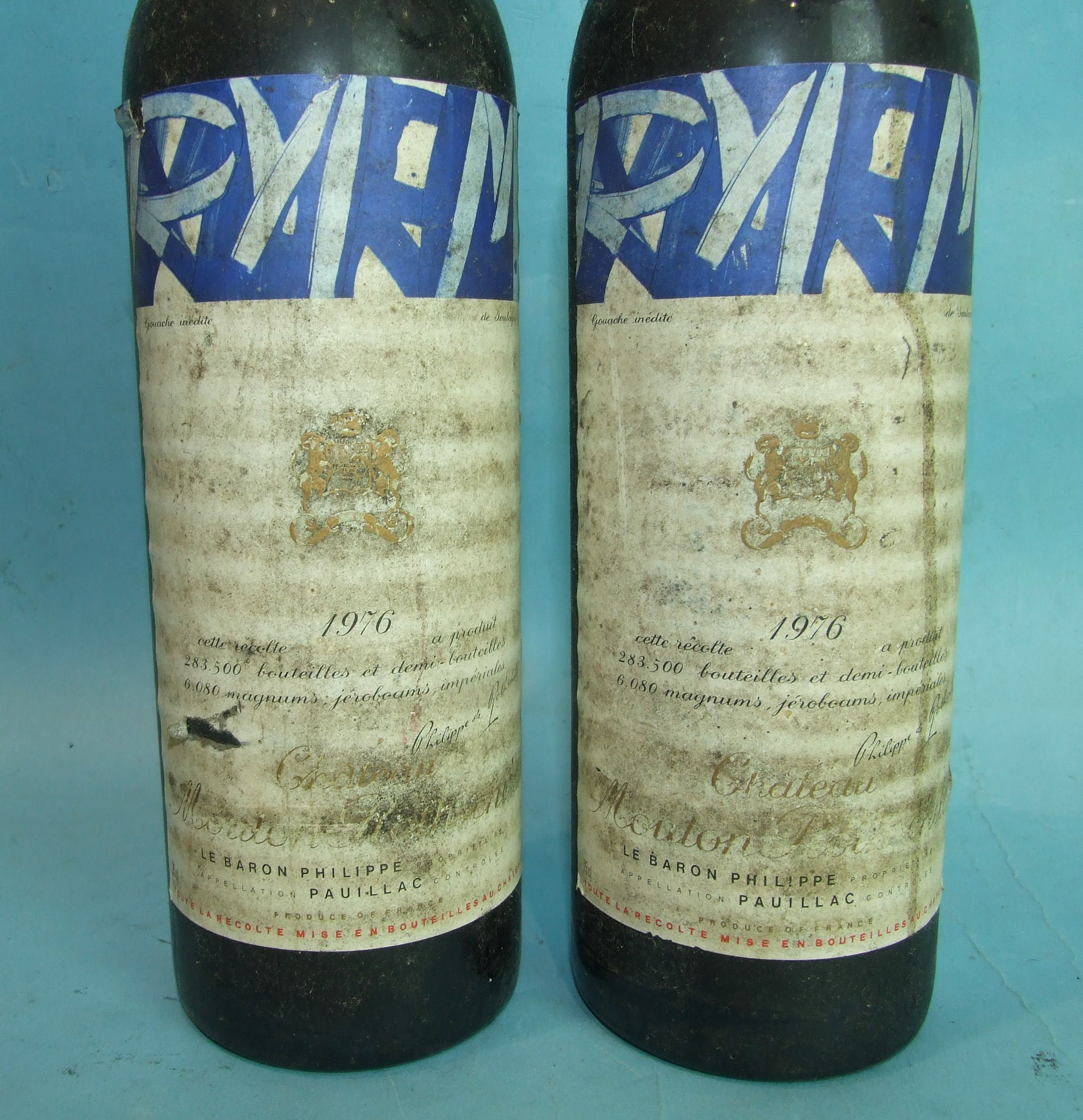 Lot 13 - Chateau Mouton Rothschild 1976, 1er Grand Cru Classé, two bottles, labels soiled, high shoulder
