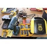 LOT CONSISTING OF: Dewalt screw gun, Ryobi impact wrench, Stanley battery charger, misc. bits