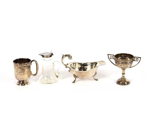 A glass and silver mounted individual whisky noggin, together with spirit label; a silver quaiche; a silver cream jug raised