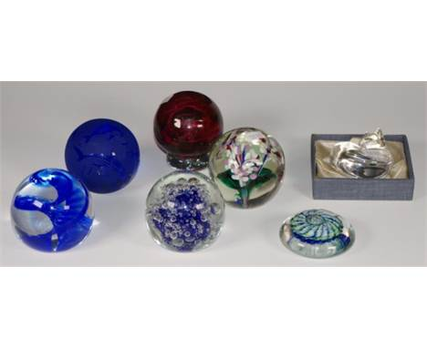 Seven various art glass paperweights to include Ogishi Mizuno, Caithness, and Steuben glass