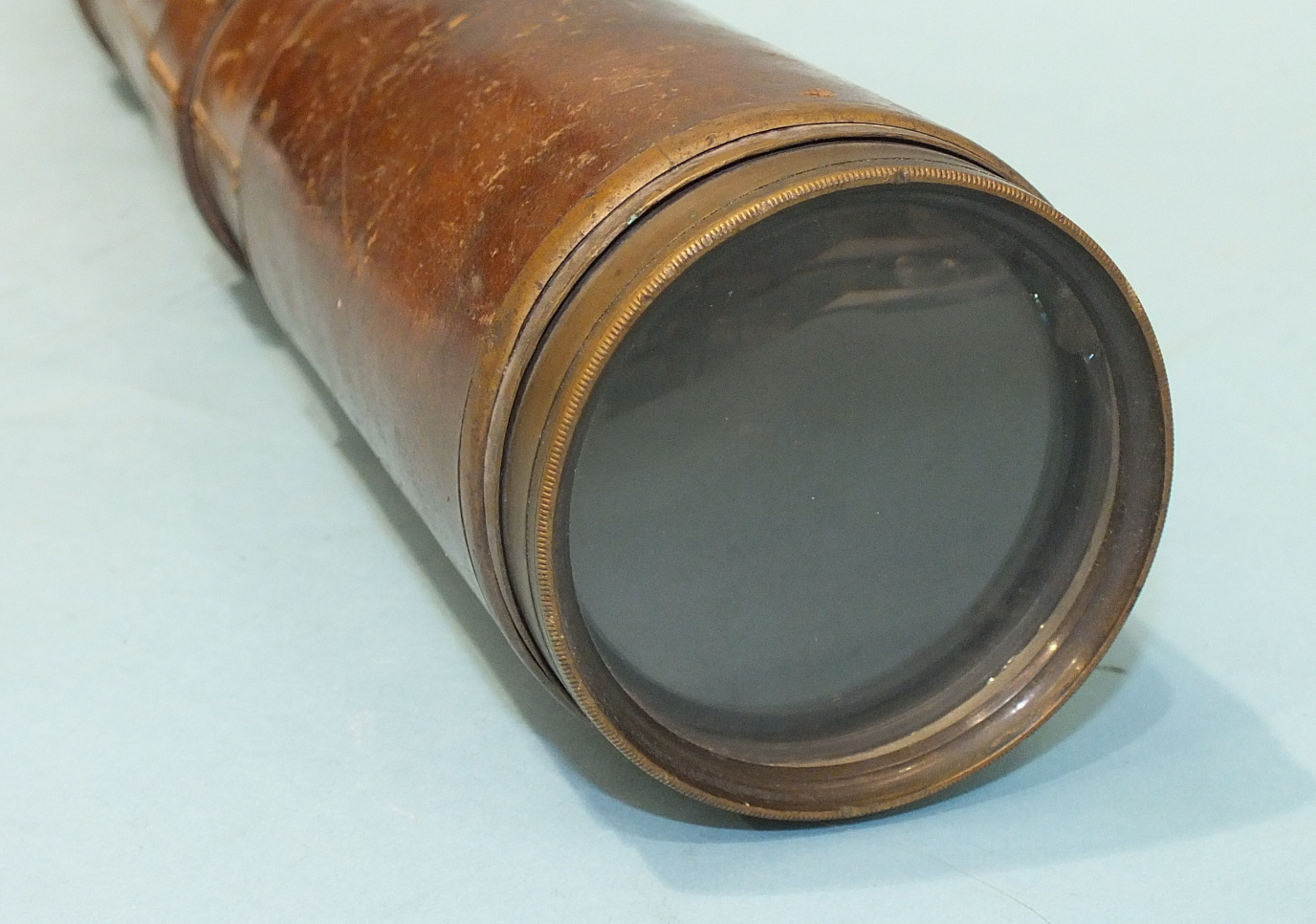 Lot 131 - A Negretti and Zambra two-draw military telescope with leather-covered grip and sun shade, dated