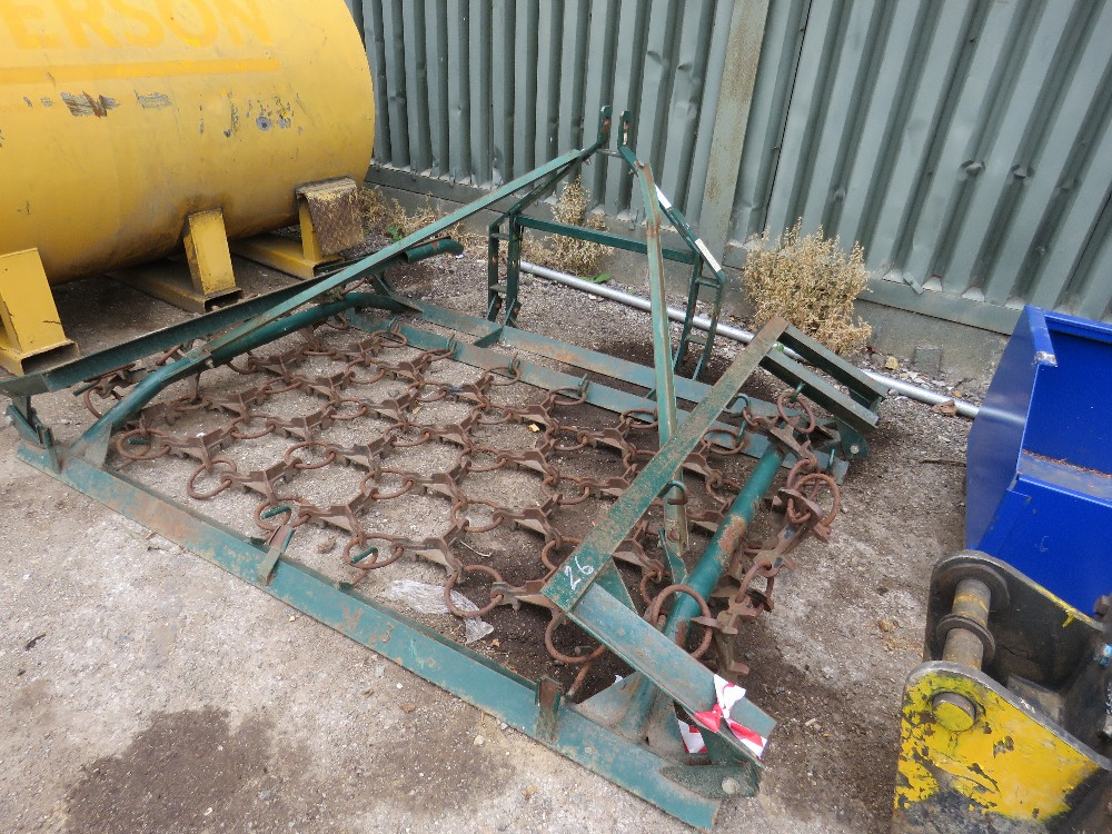Tractor mounted folding grass harrows
