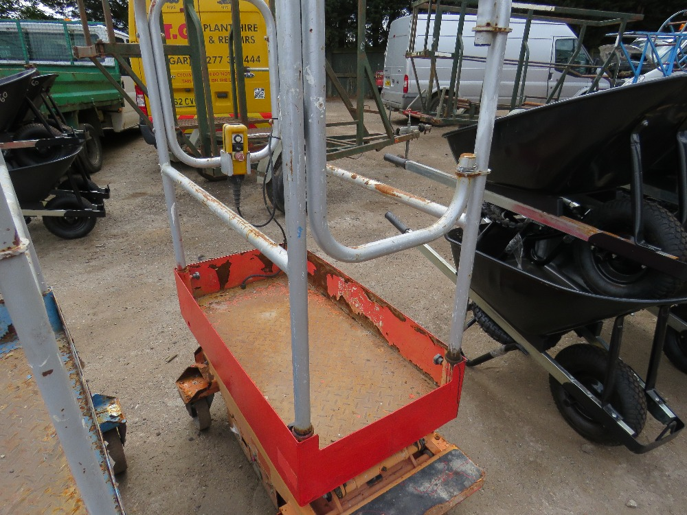 Lot 42 - POPUP POWERED SCISSOR LIFT UNIT. WHEN TESTED WAS SEEN TO LIFT AND LOWER, BATTERY LOW