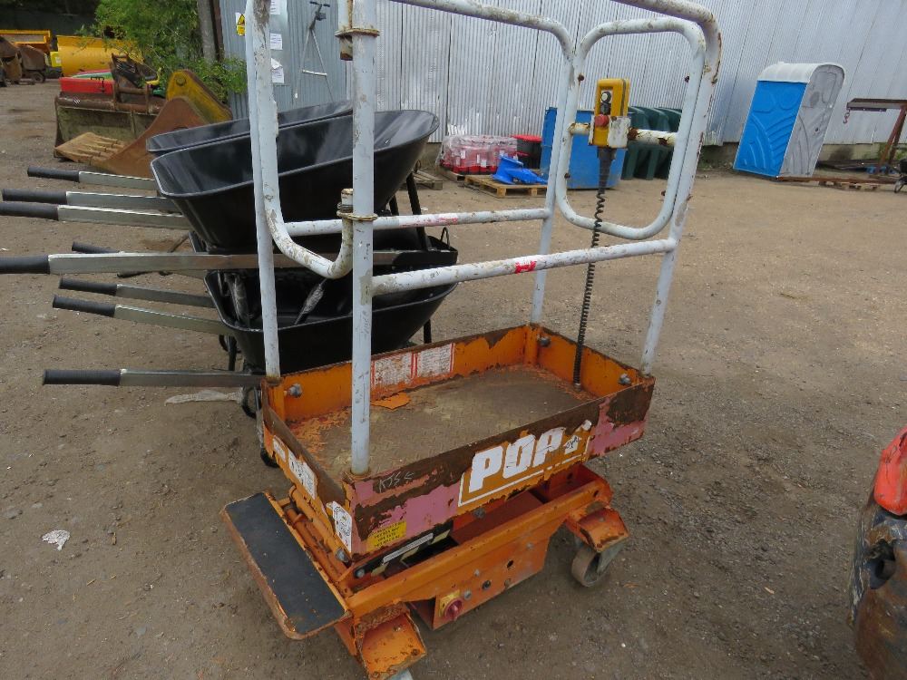 Lot 7 - POPUP POWERED SCISSOR LIFT UNIT. WHEN TESTED WAS SEEN TO LIFT AND LOWER, BATTERY LOW