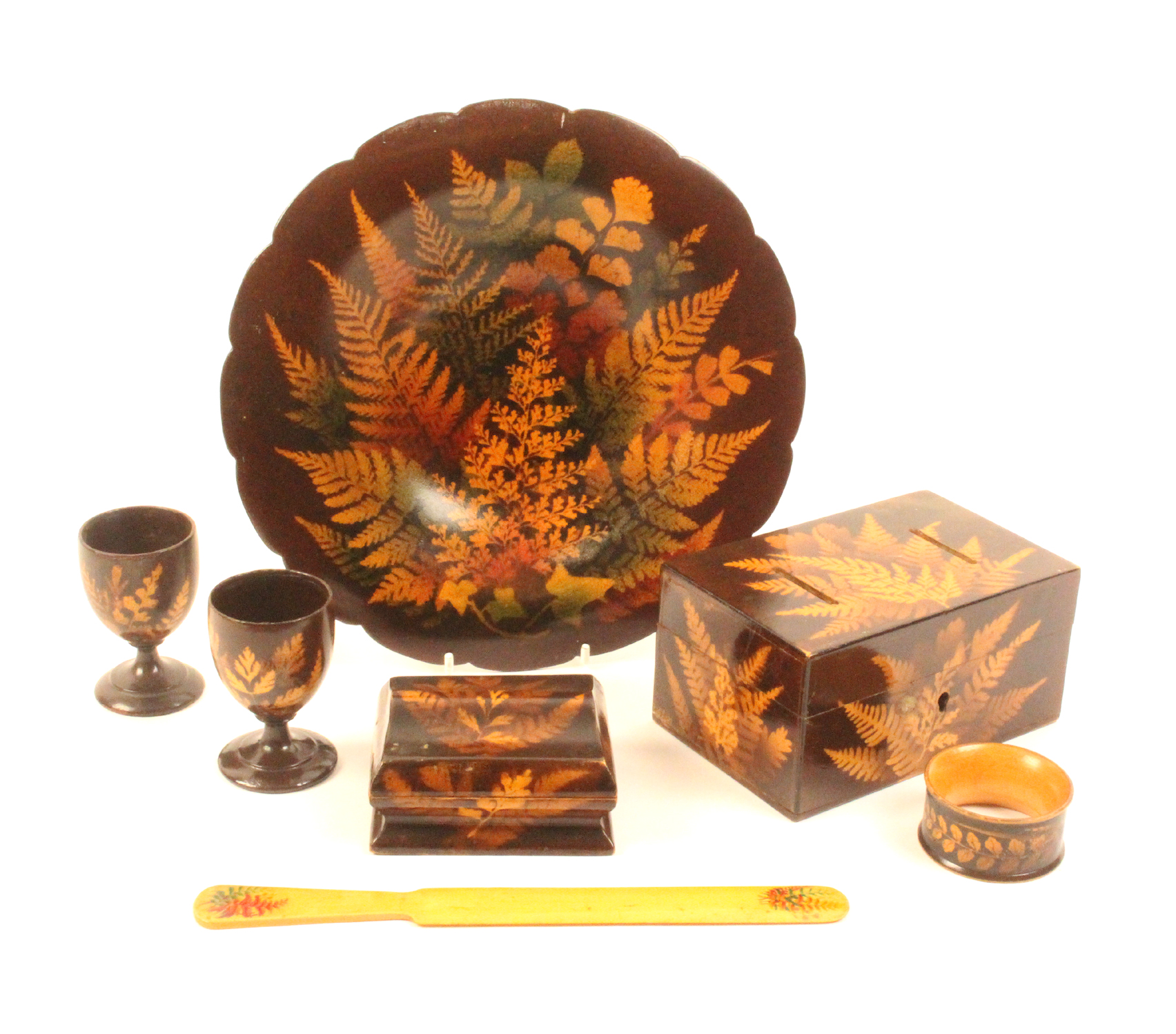 Fern ware - seven pieces comprising a shaped border circular dish, coloured ferns on a brown ground,